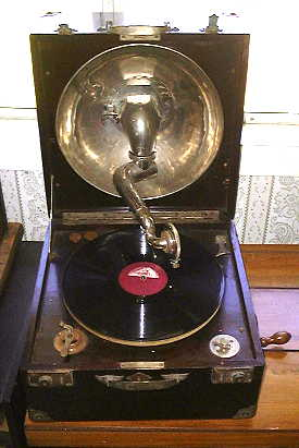 Thorens Phonograph with record, playing.